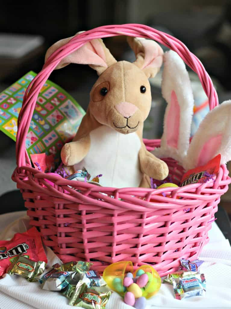 99 Easter Basket Ideas for Kids Plus Free Printable - Bunny in a pink basket