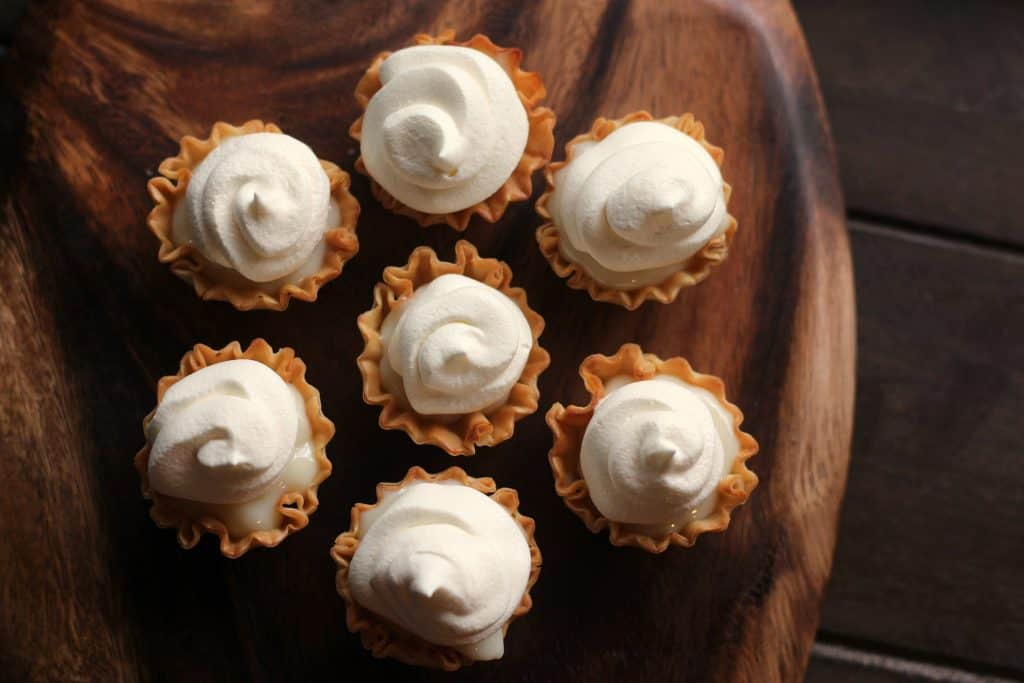 Mini Key Lime Tarts - Tarts on a wooden platter