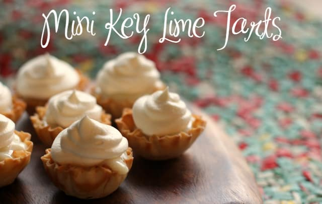 Mini Key Lime Tarts - Tarts on a wooden platter on a Pioneer Woman placemat