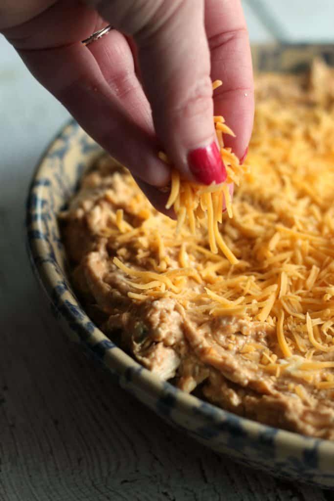BBQ Chicken Dip Recipe | Sprinkling cheese
