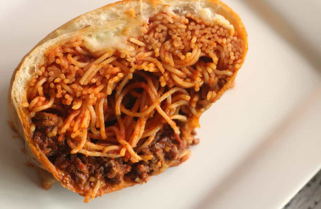 Spaghetti Stuffed Garlic Bread on a white plate