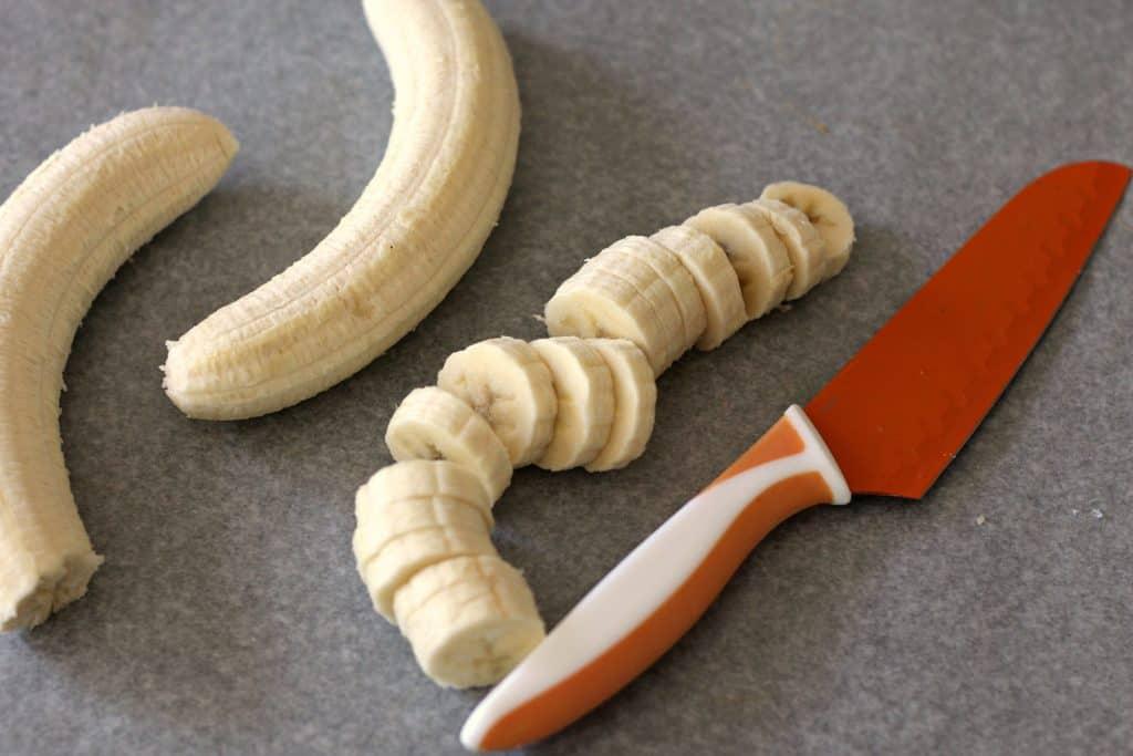 Chopping a banana for Chunky Monkey Peanut Butter Banana Bites