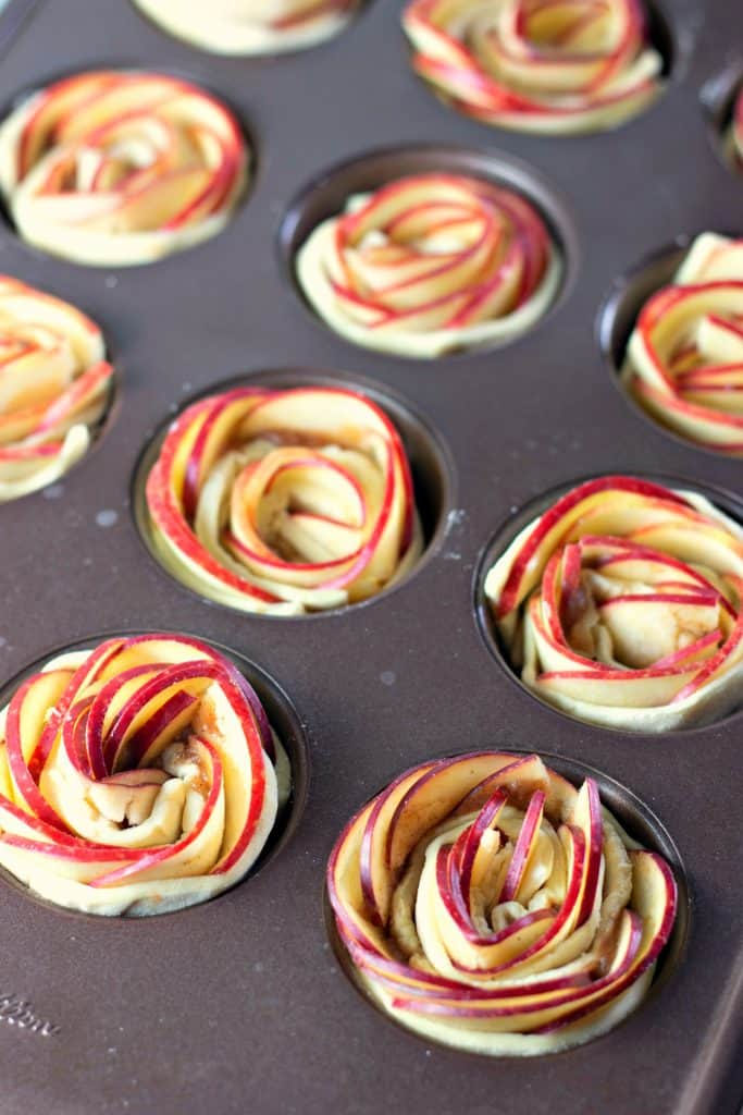 A Wilton muffin tin filled with Caramel Apple Rose Tarts ready to be baked