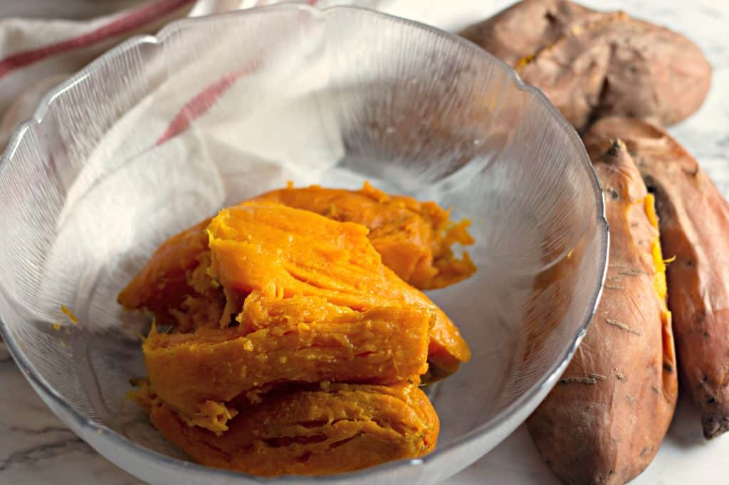 Peeling baked sweet potatoes to make Whipped Sweet Potatoes