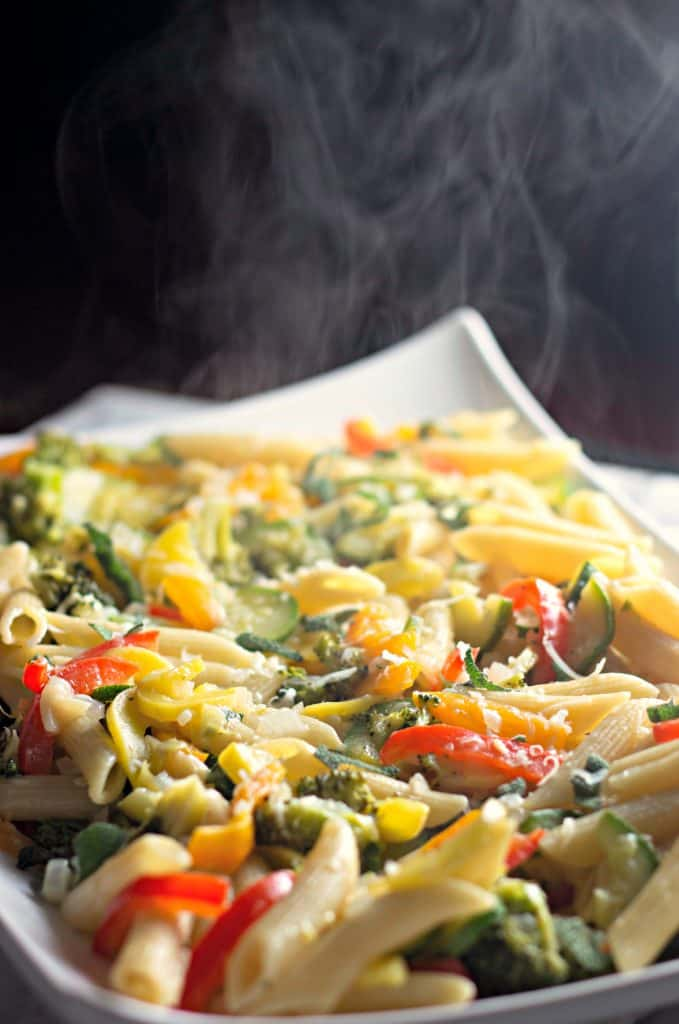 Steam rising off of Penne Primavera with Butter Sage Sauce