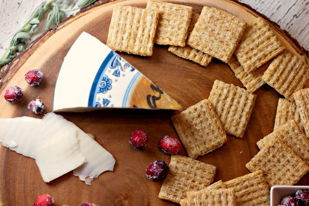 Triscuit for the Holidays with a wedge of cheese and sugared cranberries