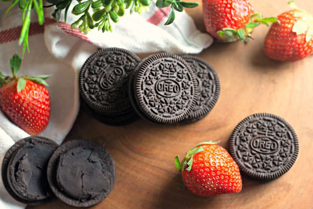 OREO Dark Chocolate with strawberries on a rustic wooden platter