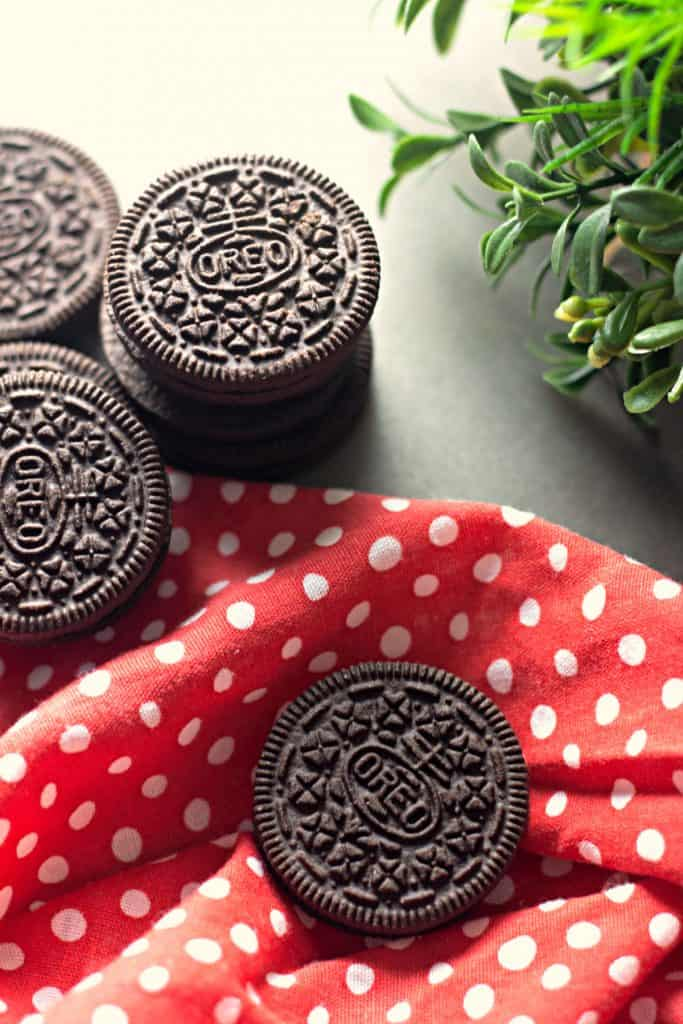 OREO Dark Chocolate on a red polka dot cloth napkin with green plant