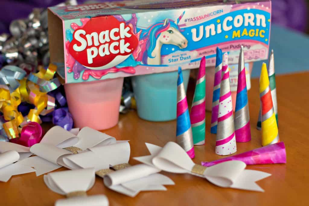Unicorn horns, bows, ribbon, and Snack Packs for making Unicorn Pudding Cups Craft