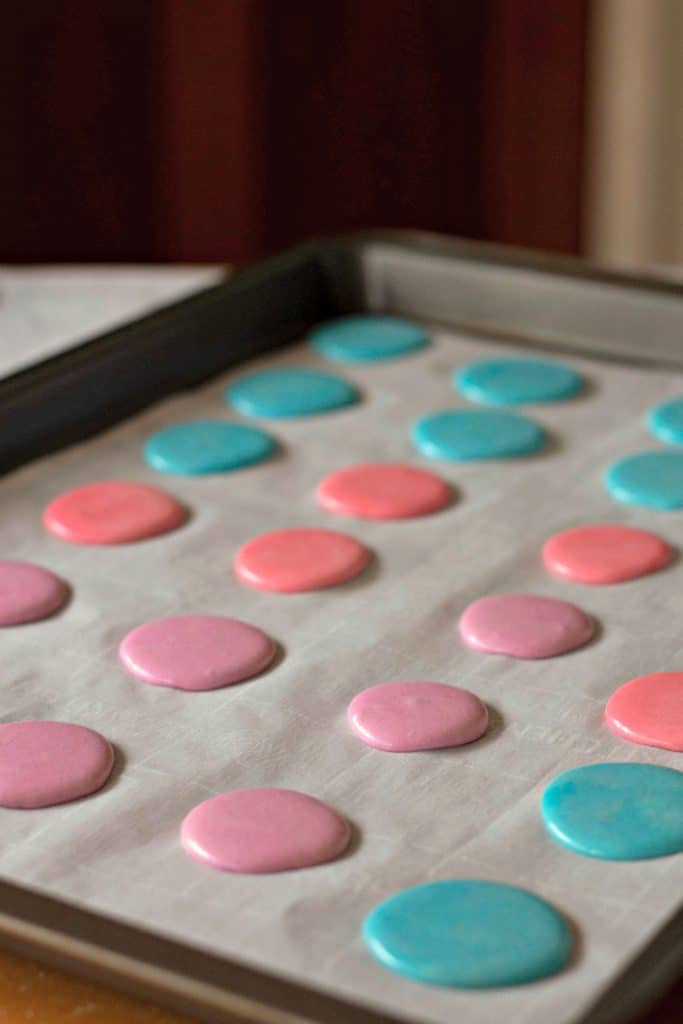 Macaron batter on a parchment paper lined baking sheet | Marshmallow PEEPS® Macaron Cookies
