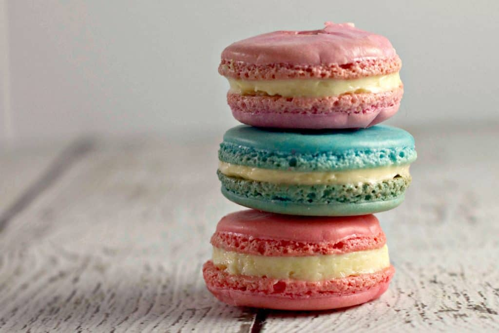 Marshmallow PEEPS® Macaron Cookies stacked on a rustic white table