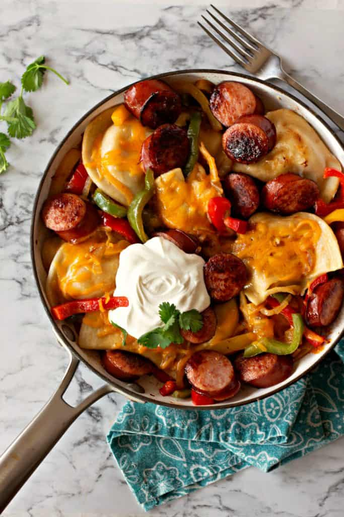 Pierogi Skillet | This delicious Pierogi Skillet combines the classic favorite potato and cheddar pierogi with freshly sautéed bell peppers and onions along with perfectly browned medallions of kielbasa. All the best flavors in one pan... dinner is served! #Pierogi #Pierogies #pierogiskillet #SkilletDinner #Dinner #DinnerRecipe #Supper #SupperRecipe #Kielbasa