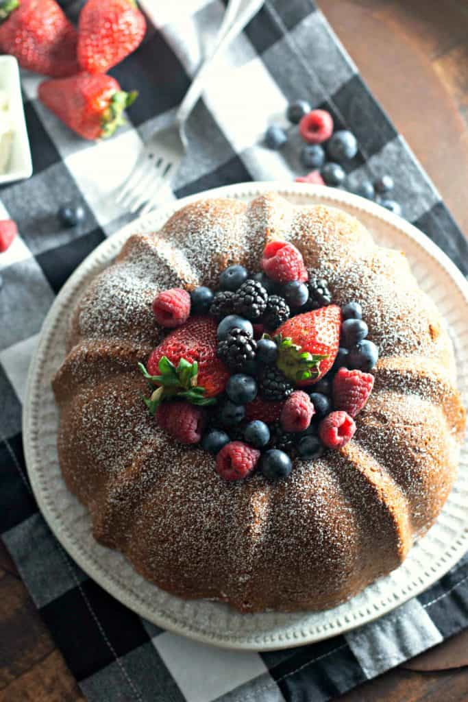 """This Cream Cheese Pound Cake Recipe is sure to be your favorite for birthday's, picnic's, potlucks, and all sorts of other occasions. The addition of cream cheese into a classic pound cake recipe means an even more rich and flavorful version of the buttery cake we all love. Serve with fresh berries and whipped cream to create the most delicious """"comfort food"""" dessert ever.