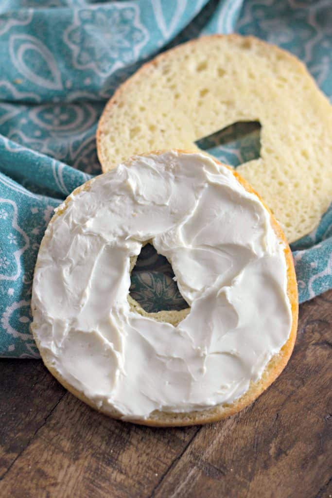 The Perfect Keto Bagels with cream cheese on a blue Pioneer Woman napkin from Walmart