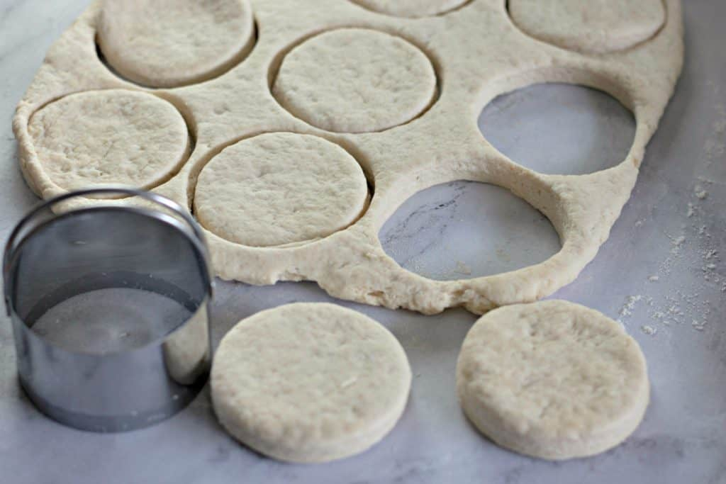 Using a biscuit cutter to make Flaky Buttermilk Biscuits Recipe
