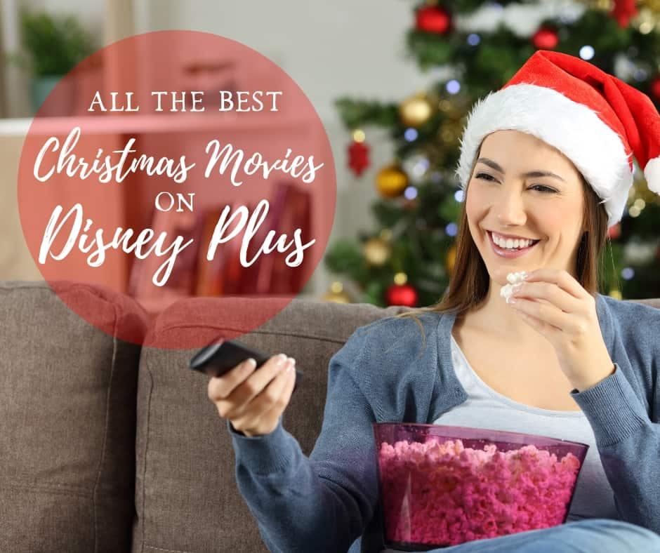 The Best Christmas Movies on Disney Plus - girl watching movies with a Santa hat and bowl of popcorn