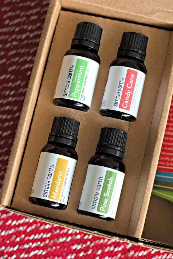 Simply Earth December Essential Oils Recipe Box with peppermint, candy cane, mandarin, and pine scotch oils