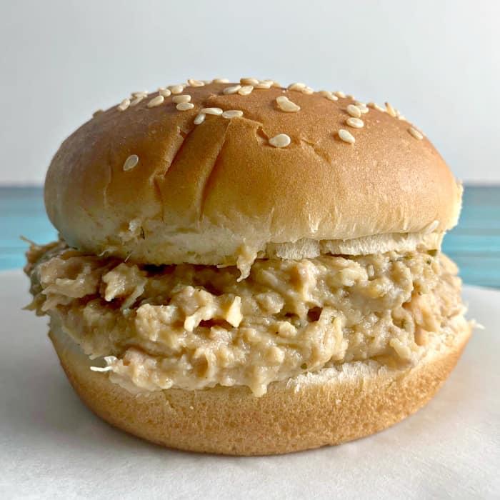 Crockpot Ohio Shredded Chicken Sandwiches on a sesame seed bun