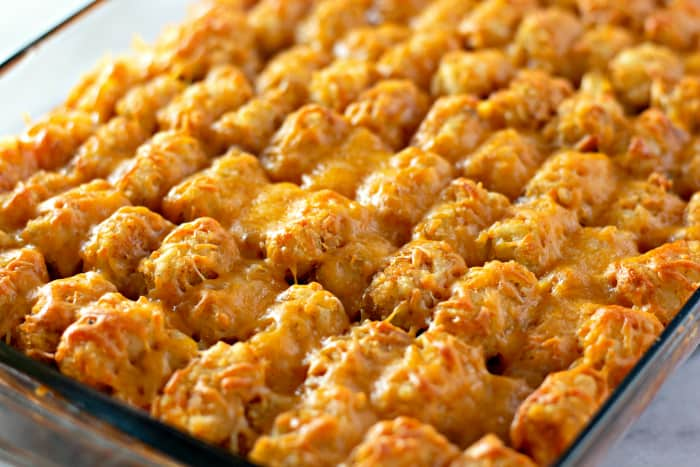 Baked tater tots covered in melted cheese