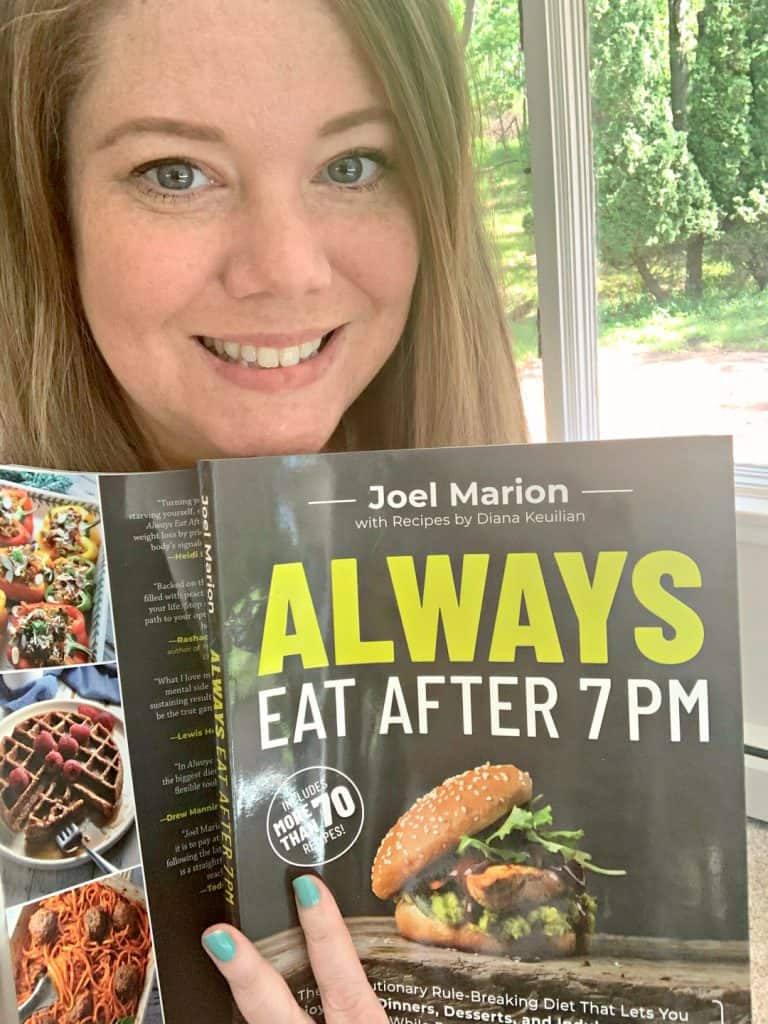 Carissa Shaw holding a copy of Always Eat After 7PM