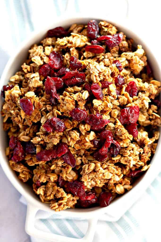 Homemade Granola with Cranberries in a white bowl