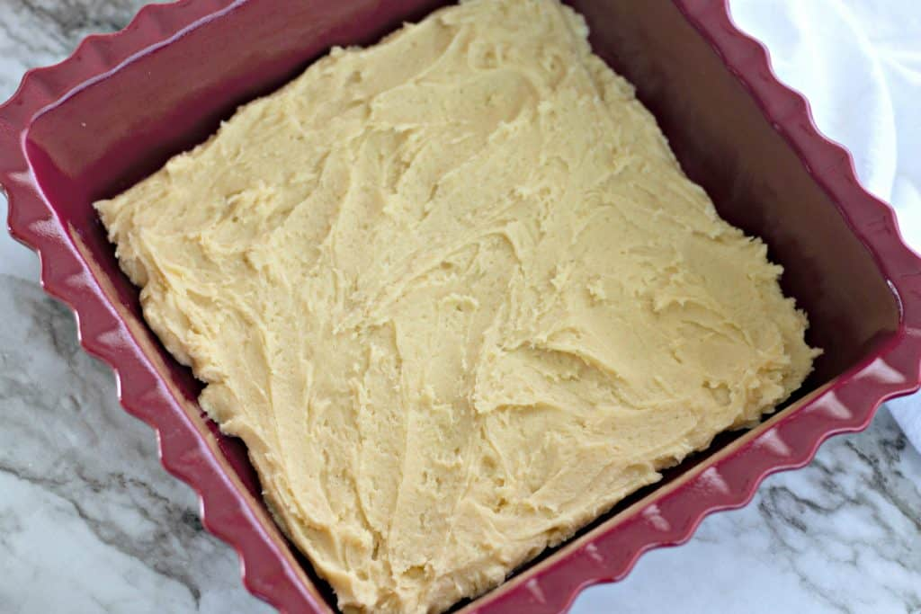 cookie dough spread into a square baking dish