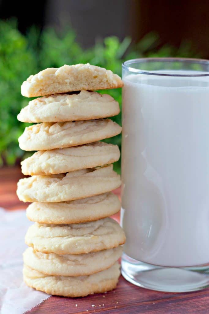 Amish Sugar Cookie Recipe stacked next to a glass of milk