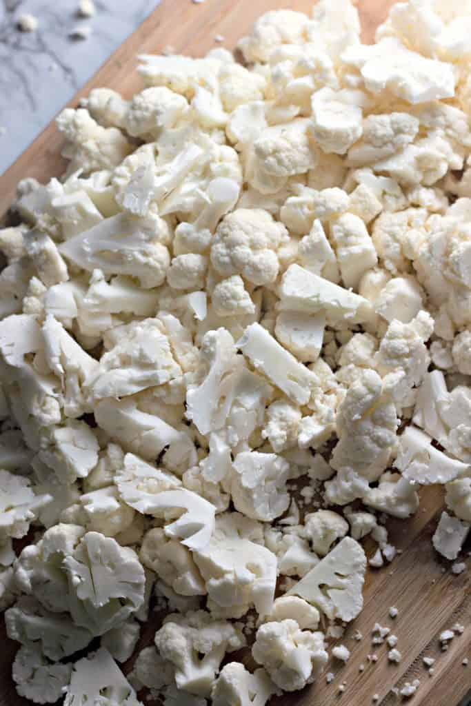 chopped fresh cauliflower on a cutting board