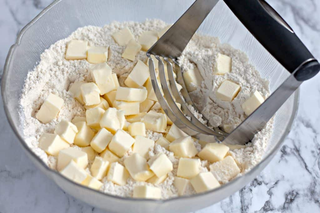 cutting butter into flour with a pastry blender
