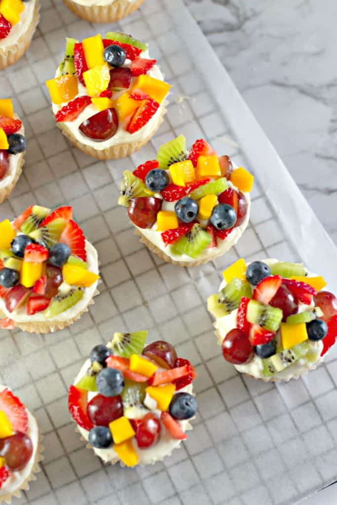 finished Fruit Pizza Cupcakes on a wire cooling rack