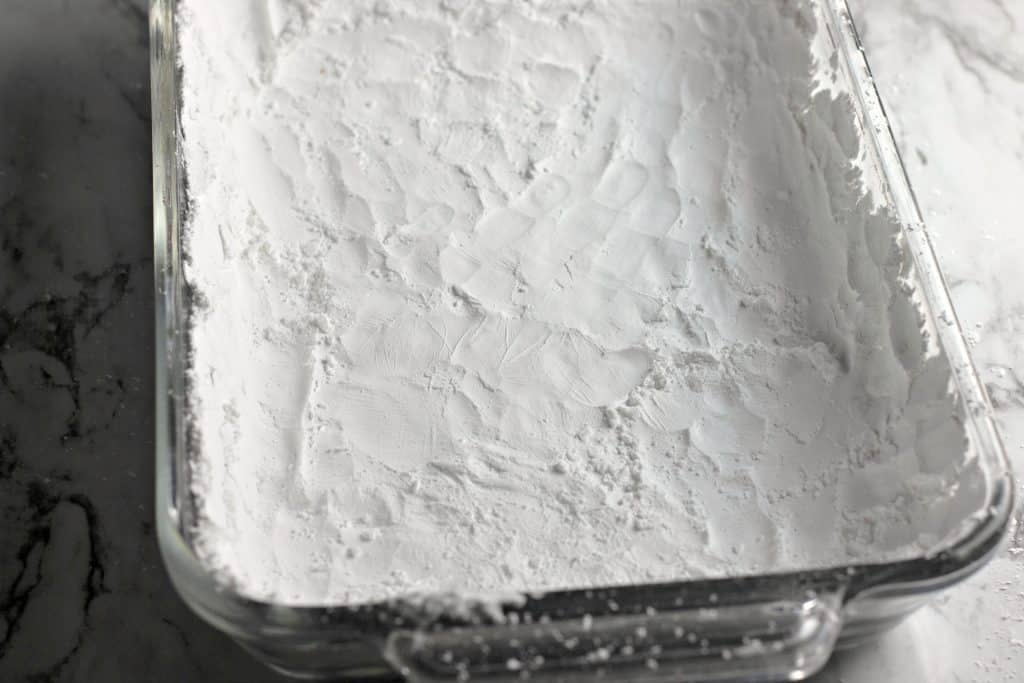 Pyrex dish coated in powdered sugar