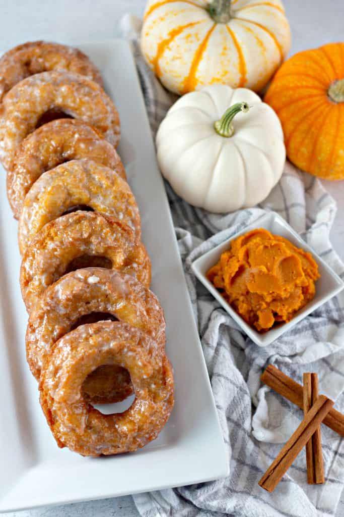 Pumpkin Buttermilk Donuts on a white platter
