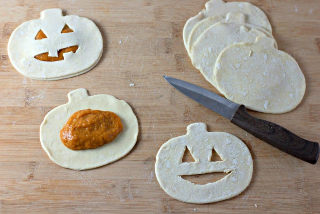 cutting jack-o-lantern faces into puff pastry