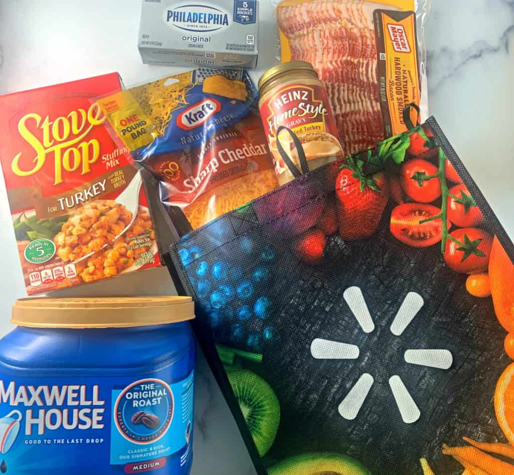 Maxwell House Coffee, Stove Top Stuffing, Philadelphia Cream Cheese, Heinz Home Style turkey gravy, Kraft Sharp Cheddar Cheese, Oscar Meyer bacon in a Walmart reusable shopping bag