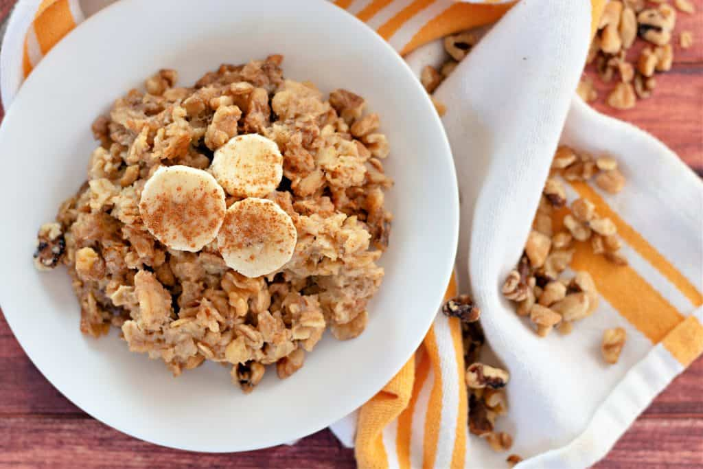 Banana Bread Baked Oatmeal on a white plate with walnuts