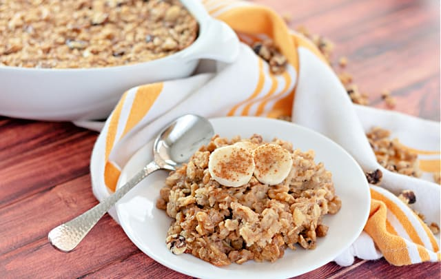 Banana Bread Baked Oatmeal on a white plate with a spoon