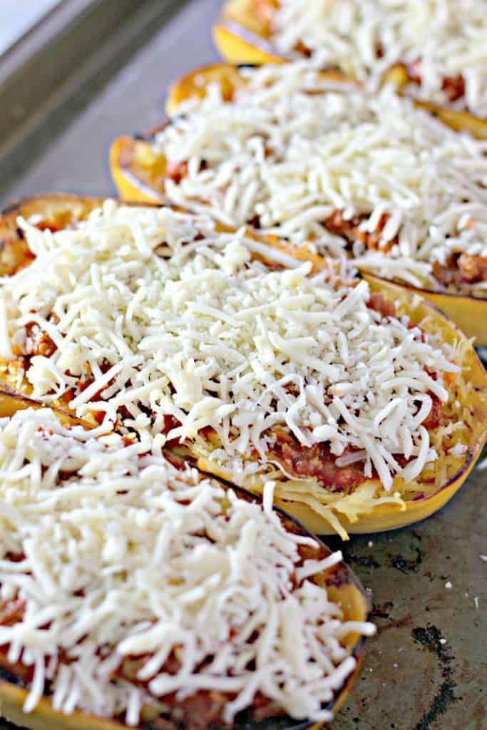 adding mozzarella cheese on top of the squash
