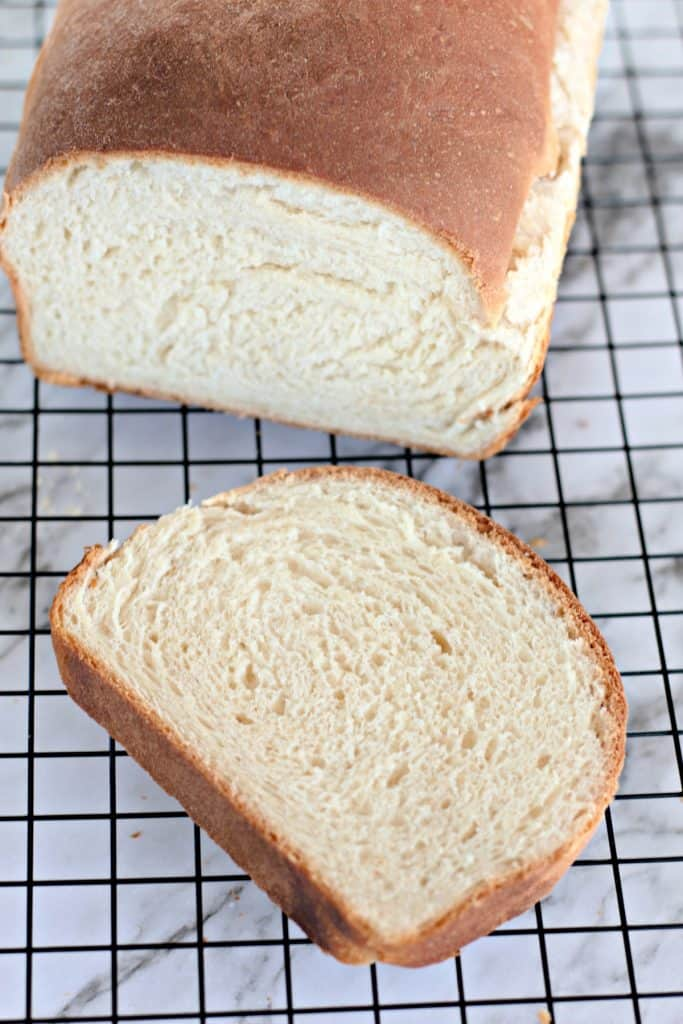 a slice of homemade bread on a wire cooling rack.