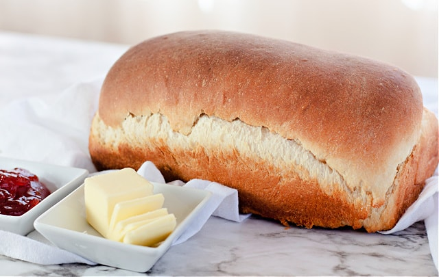 The Best Homemade Bread in a Bag with butter and jam.