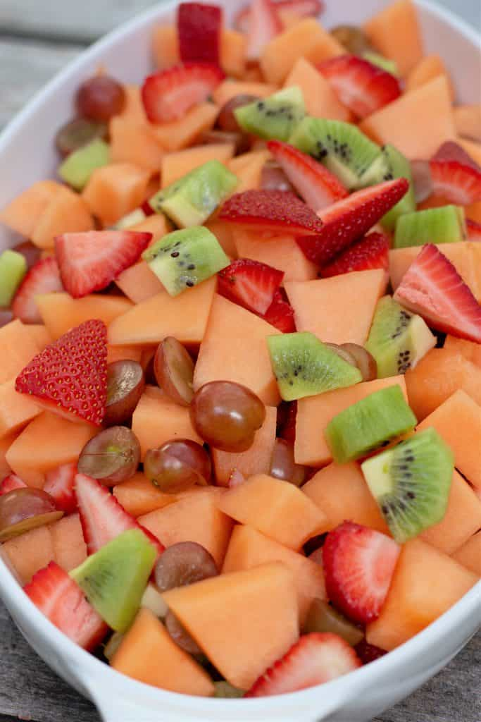 fresh fruit salad in a white dish.