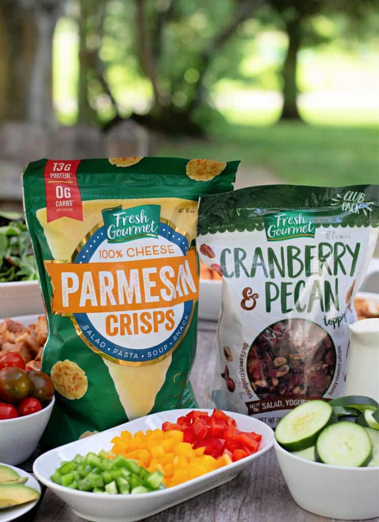 Fresh Gourmet Parmesan Cheese Crisps and Cranberry Pecan salad toppings on a table set up as a salad bar.